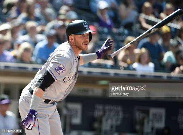 Trevor Story of the Colorado Rockies hits an RBI double during the sixth inning of a baseball game against the San Diego Padres at PETCO Park on...