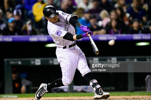Trevor Story of the Colorado Rockies hits his third home run in the sixth inning in a baseball game against the San Francisco Giants on September 5...