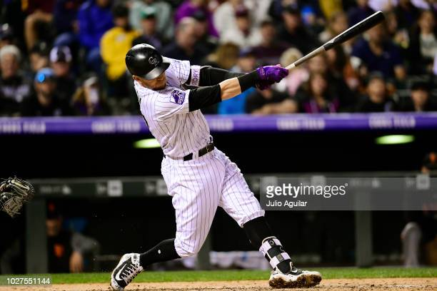 Trevor Story of the Colorado Rockies hits his third homer in the sixth inning in a baseball game against the San Francisco Giants on September 5 2018...