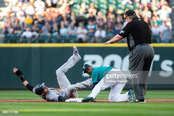 Trevor Story of the Colorado Rockies is called safe at second beating the tag by Jean Segura of the Seattle Mariners in the third inning at Safeco...