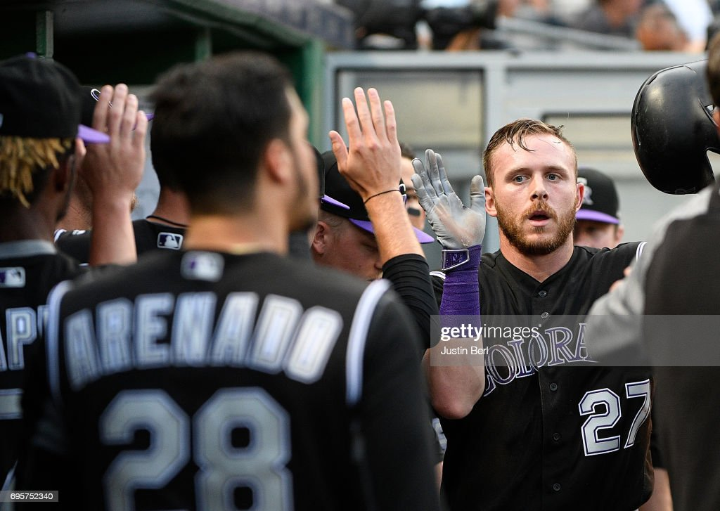 Trevor Story #27 of the Colorado Rockies is greeted by teammates in the dugout after scoring on an RBI single by Tony Wolters #14 in the fifth inning at PNC Park on June 13, 2017 in Pittsburgh, Pennsylvania.