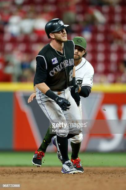 Trevor Story of the Colorado Rockies is tagged out by Alex Blandino of the Cincinnati Reds after over running second base during the eighth inning at...