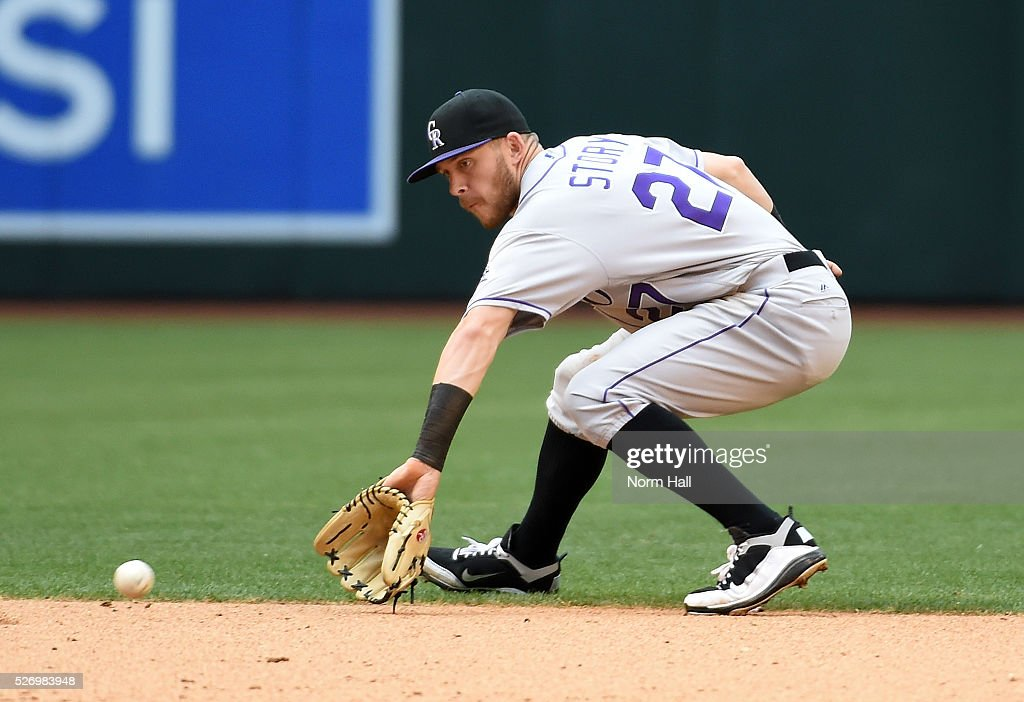 Trevor Story #27 of the Colorado Rockies makes a backhand play on a ground ball by Chris Herrmann #10 of the Arizona Diamondbacks who is forced out at first base during the eighth inning at Chase Field on May 01, 2016 in Phoenix, Arizona. Rockies won 6-3.