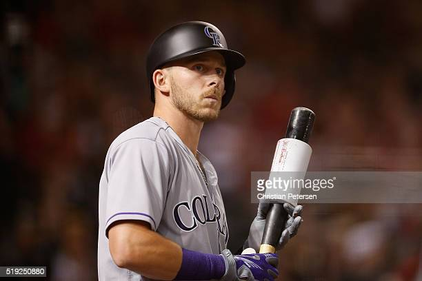 Trevor Story of the Colorado Rockies on deck during the MLB opening day game against the Arizona Diamondbacks at Chase Field on April 4 2016 in...