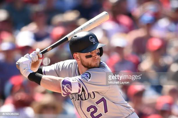 Trevor Story of the Colorado Rockies prepares for a pitch during game one of a doubleheader baseball game against the Washington Nationals at...
