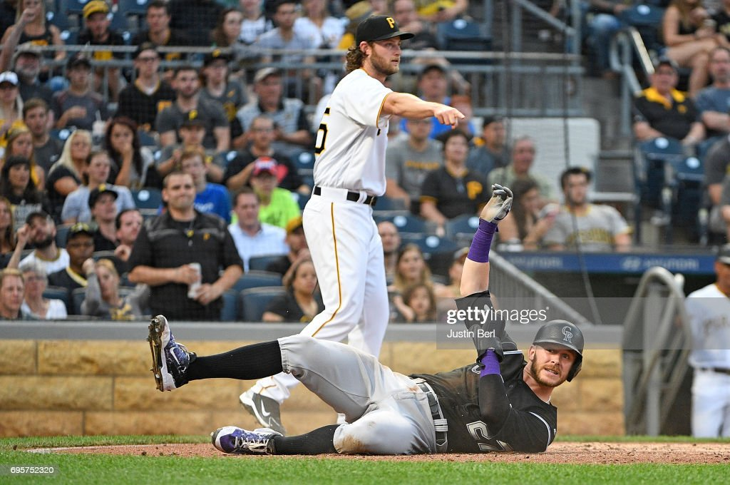 Trevor Story #27 of the Colorado Rockies reacts after coming around to score in the fifth inning during the game against the Pittsburgh Pirates at PNC Park on June 13, 2017 in Pittsburgh, Pennsylvania.