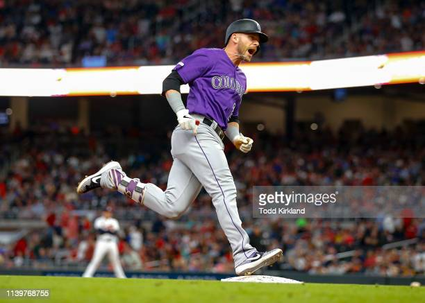 Trevor Story of the Colorado Rockies reacts as he rounds third after hitting a three run home run in the ninth inning of an MLB game against the...