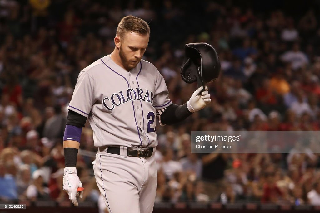 Trevor Story #27 of the Colorado Rockies reacts to a strike out against the Arizona Diamondbacks during the third innign of the MLB game at Chase Field on September 12, 2017 in Phoenix, Arizona.