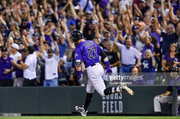 Trevor Story of the Colorado Rockies rounds the bases after hitting a three run homrun against the Arizona Diamondbacks in the fifth inning of a game...