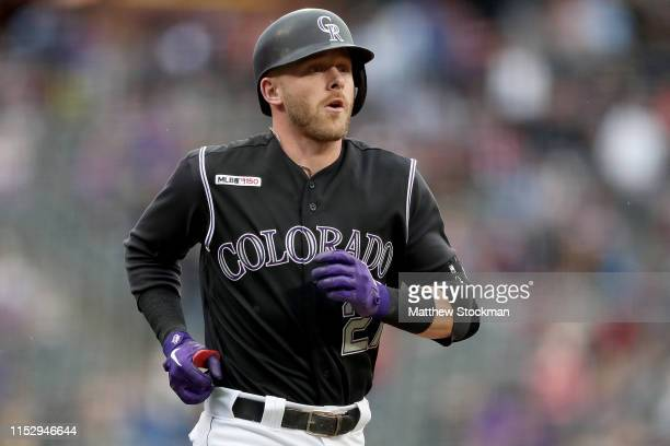 Trevor Story of the Colorado Rockies rounds the bases after hitting a 2 RBI home run in the first inning against the Toronto Blue Jays at Coors Field...