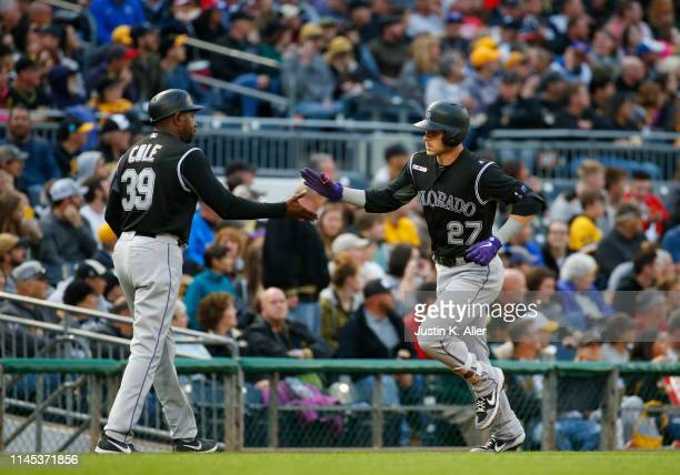 Trevor Story of the Colorado Rockies rounds third after hitting a home run in the second inning against the Pittsburgh Pirates at PNC Park on May 21,...