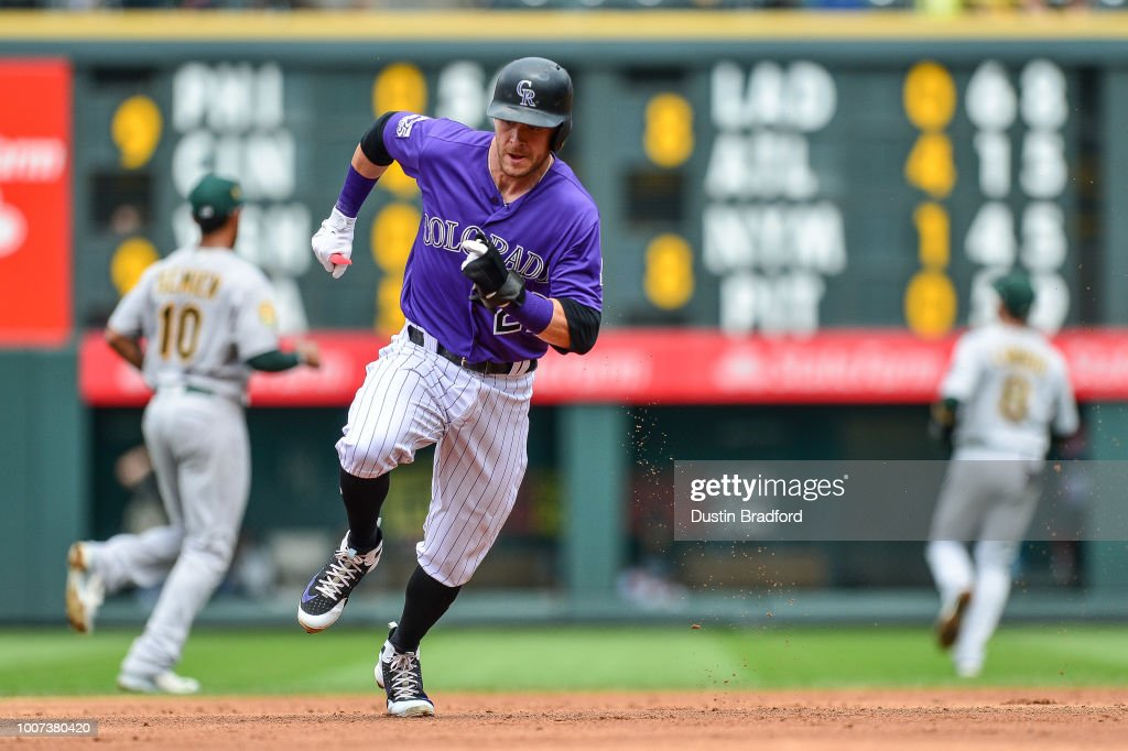 Trevor Story #27 of the Colorado Rockies runs the base path to score a third inning run from first base on a double by Ryan McMahon during a game against the Oakland Athletics during interleague play at Coors Field on July 29, 2018 in Denver, Colorado.