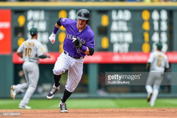 Trevor Story of the Colorado Rockies runs the base path to score a third inning run from first base on a double by Ryan McMahon during a game against...