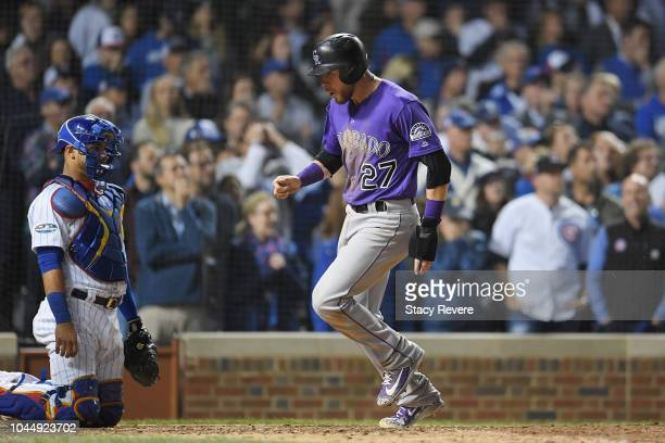 Trevor Story of the Colorado Rockies scores a run in the thirteenth inning to give the Rockies a 21 lead against the Chicago Cubs during the National...