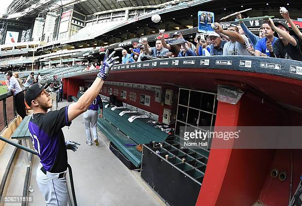 Trevor Story of the Colorado Rockies signs autographs for fans prior to a game against the Arizona Diamondbacks on April 29 2016 in Phoenix Arizona
