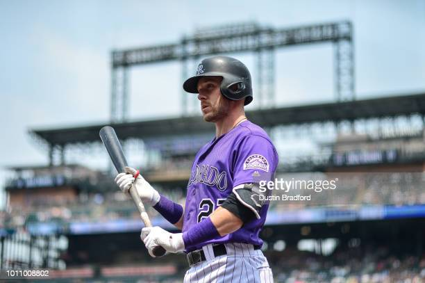 Trevor Story of the Colorado Rockies stands in the on deck circle before batting against the Oakland Athletics during interleague play at Coors Field...