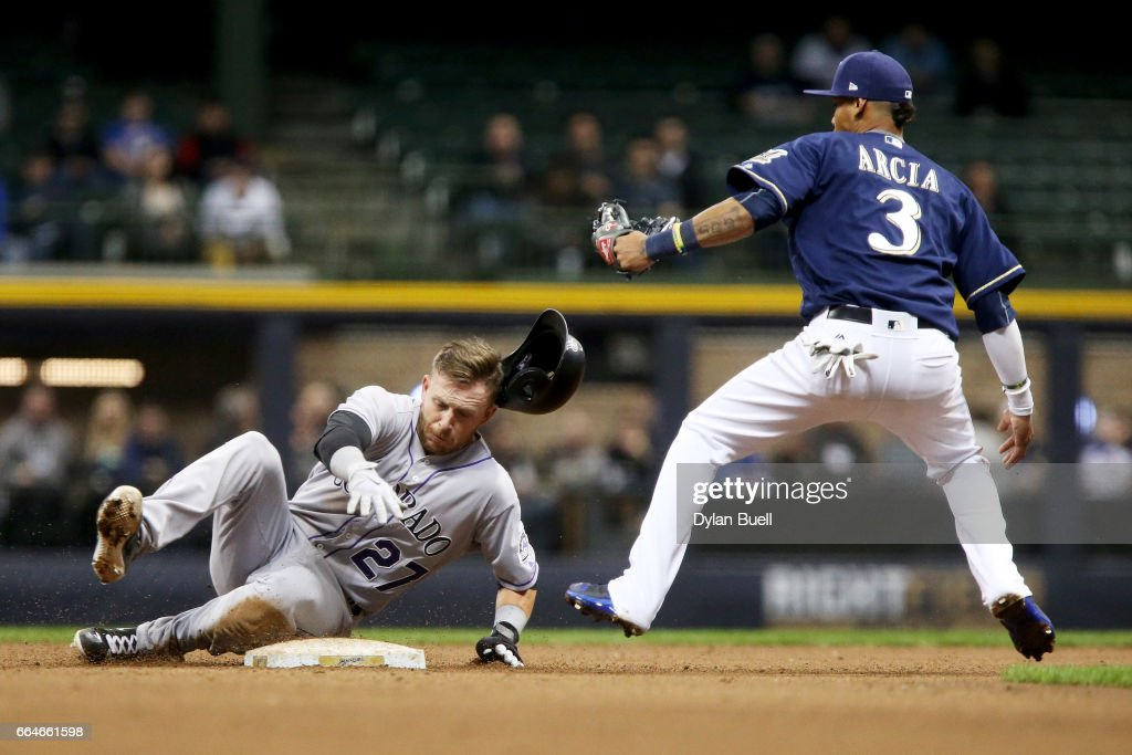 Trevor Story #27 of the Colorado Rockies steals second base past Orlando Arcia #3 of the Milwaukee Brewers in the ninth inning at Miller Park on April 4, 2017 in Milwaukee, Wisconsin.