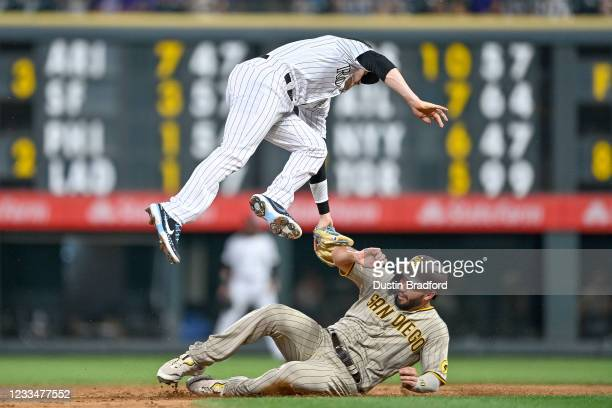Trevor Story of the Colorado Rockies tags out Eric Hosmer of the San Diego Padres on a steal attempt to end the top of the sixth inning of a game at...