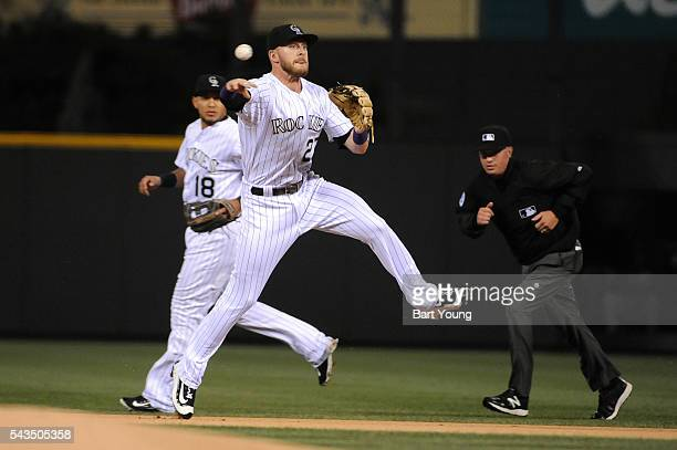 Trevor Story of the Colorado Rockies throws to first base in the first inning for the out against the Toronto Blue Jays at Coors Field on June 28...