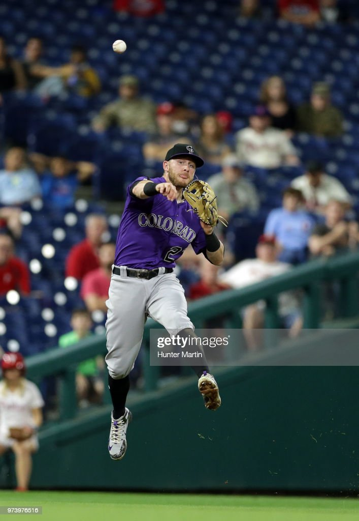 Trevor Story #27 of the Colorado Rockies throws to first for an out after fielding a ground ball in the seventh inning during a game against the Philadelphia Phillies at Citizens Bank Park on June 13, 2018 in Philadelphia, Pennsylvania. The Rockies won 7-2.