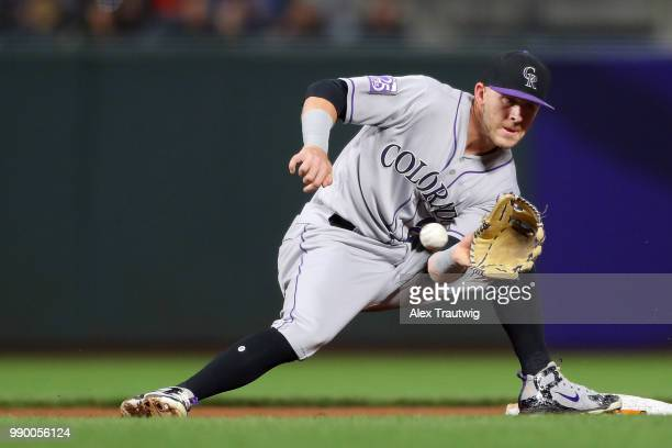 Trevor Story of the Colorado Rockies tries to make a catch at second base during a game against the San Francisco Giants at ATT Park on Tuesday June...