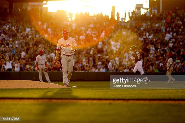 Trevor Story of the Colorado Rockies trots around the bases after hitting a solo home run off of Adam Morgan of the Philadelphia Phillies during the...