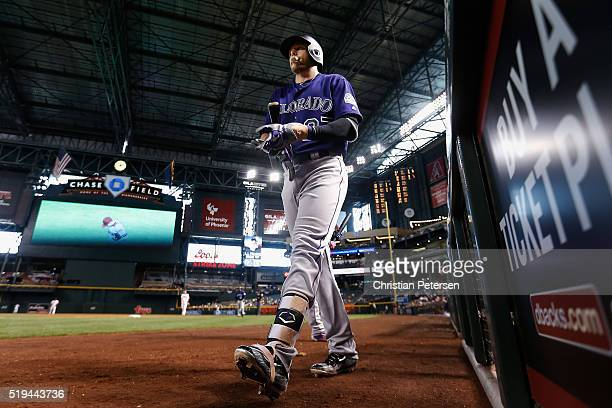 Trevor Story of the Colorado Rockies walks from the dugout during the sixth inning of the MLB game against the Arizona Diamondbacks at Chase Field on...