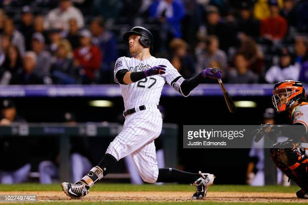 Trevor Story of the Colorado Rockies watches his second home run of the night during the fourth inning against the San Francisco Giants at Coors...