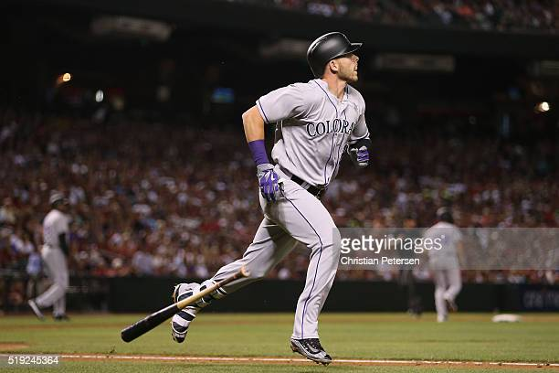 Trevor Story of the Colorado Rockies watches his threerun home run against the Arizona Diamondbacks hit during the third inning of the MLB opening...