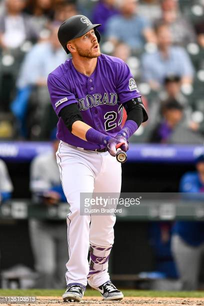 Trevor Story of the Colorado Rockies watches the flight of a ninth inning solo homerun against the Los Angeles Dodgers during the Colorado Rockies...