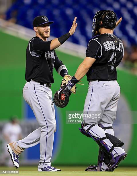 Trevor Story shakes hands with Nick Hundley of the Colorado Rockies after the game against the Miami Marlins at Marlins Park on June 20 2016 in Miami...