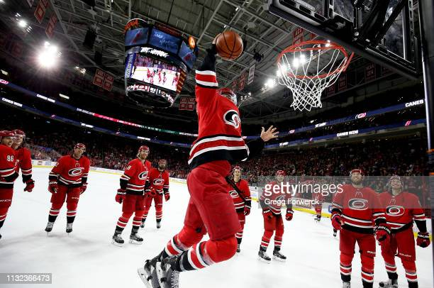 Trevor van Riemsdyk of the Carolina Hurricanes dunks a basketball during the Storm Surge following an NHL game against the Minnesota Wild on March 23...