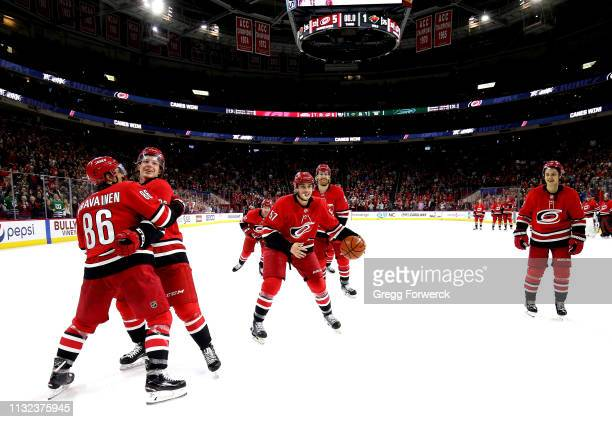 Trevor van Riemsdyk of the Carolina Hurricanes participates in the Storm Surge with teammates Brock McGinn Teuvo Teravainen and Sebastian Aho...