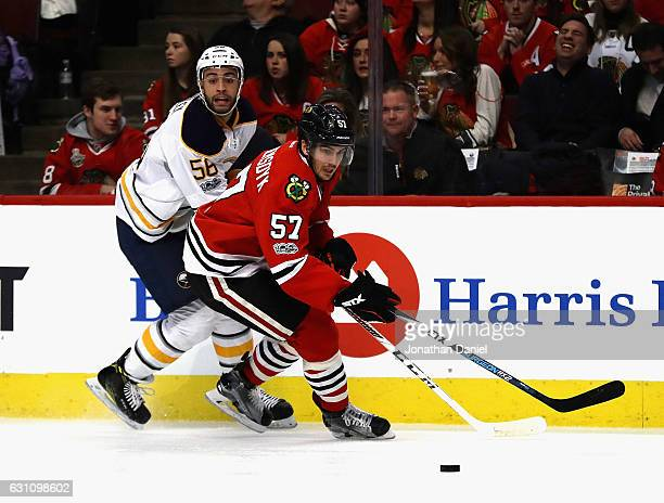 Trevor van Riemsdyk of the Chicago Blackhawks and Justin Bailey of the Buffalo Sabres moves to the puck at the United Center on January 5, 2017 in...