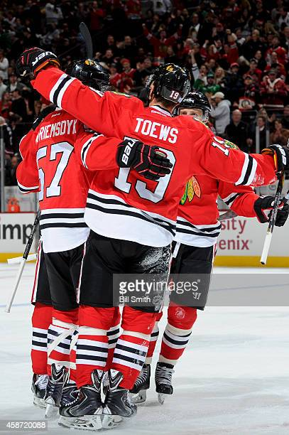Trevor van Riemsdyk of the Chicago Blackhawks celebrates with teammates after scoring a goal during the NHL game against the San Jose Sharks on...