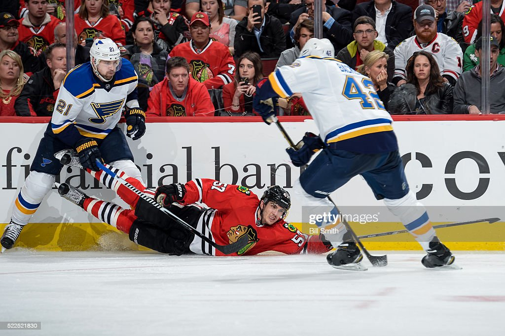 Trevor van Riemsdyk #57 of the Chicago Blackhawks slides in front of Patrik Berglund #21 of the St. Louis Blues in the third period of Game Four of the Western Conference First Round during the 2016 NHL Stanley Cup Playoffs at the United Center on April 19, 2016 in Chicago, Illinois.