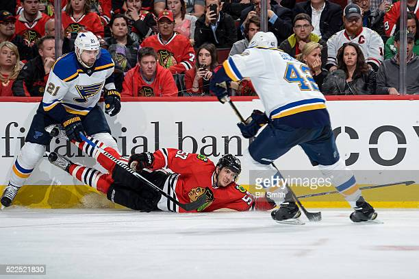 Trevor van Riemsdyk of the Chicago Blackhawks slides in front of Patrik Berglund of the St Louis Blues in the third period of Game Four of the...