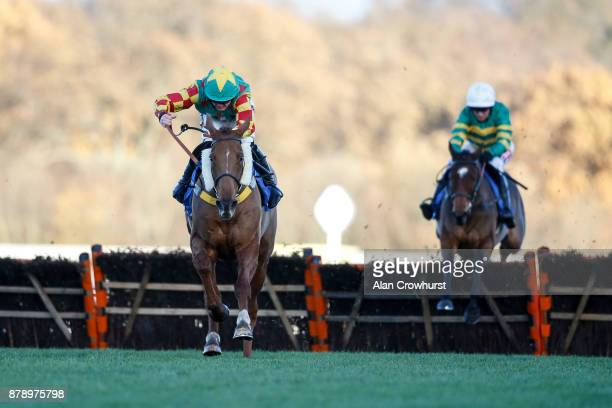 Trevor Whelan riding Lil Rockerfeller clear the last to win The Coral Hurdle Race at Ascot racecourse on November 25 2017 in Ascot United Kingdom