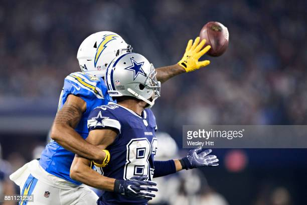 Trevor Williams of the Los Angeles Chargers reaches around and knocks away a pass thrown to Terrance Williams of the Dallas Cowboys at ATT Stadium on...