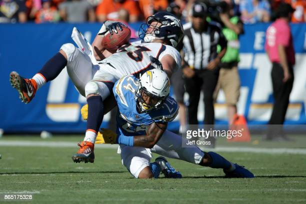 Trevor Williams of the Los Angeles Chargers tackles De'Angelo Henderson of the Denver Broncos during the third quarter of the game at the StubHub...