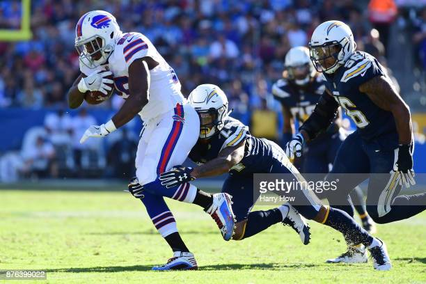 Trevor Williams of the Los Angeles Chargers tackles LeSean McCoy of the Buffalo Bills during the first half of the game at StubHub Center on November...