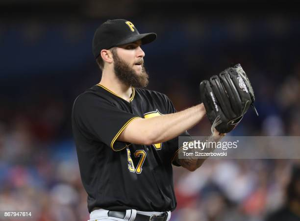 Trevor Williams of the Pittsburgh Pirates looks in before delivering a pitch in the fourth inning during MLB game action against the Toronto Blue...