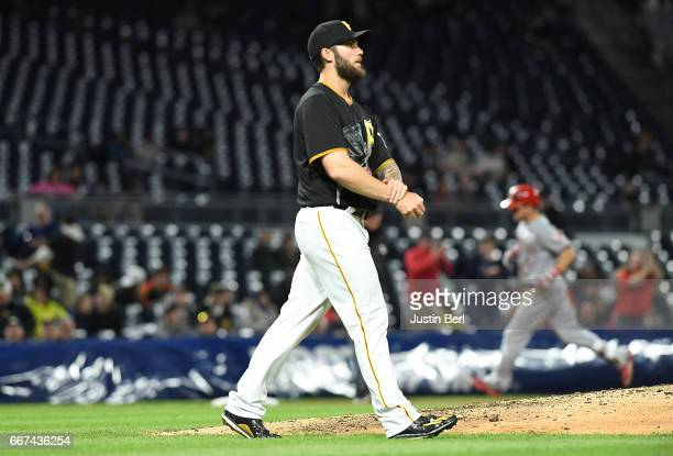 Trevor Williams of the Pittsburgh Pirates reacts as Scooter Gennett of the Cincinnati Reds rounds the bases after hitting a three run home run in the...