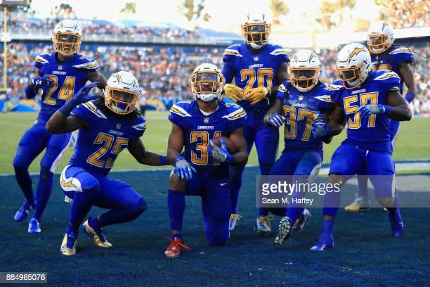 Trevor Williams Rayshawn Jenkins Adrian Phillips Casey Hayward Jahleel Addae Jatavis Brown and Michael Davis of the Los Angeles Chargers celebrate...