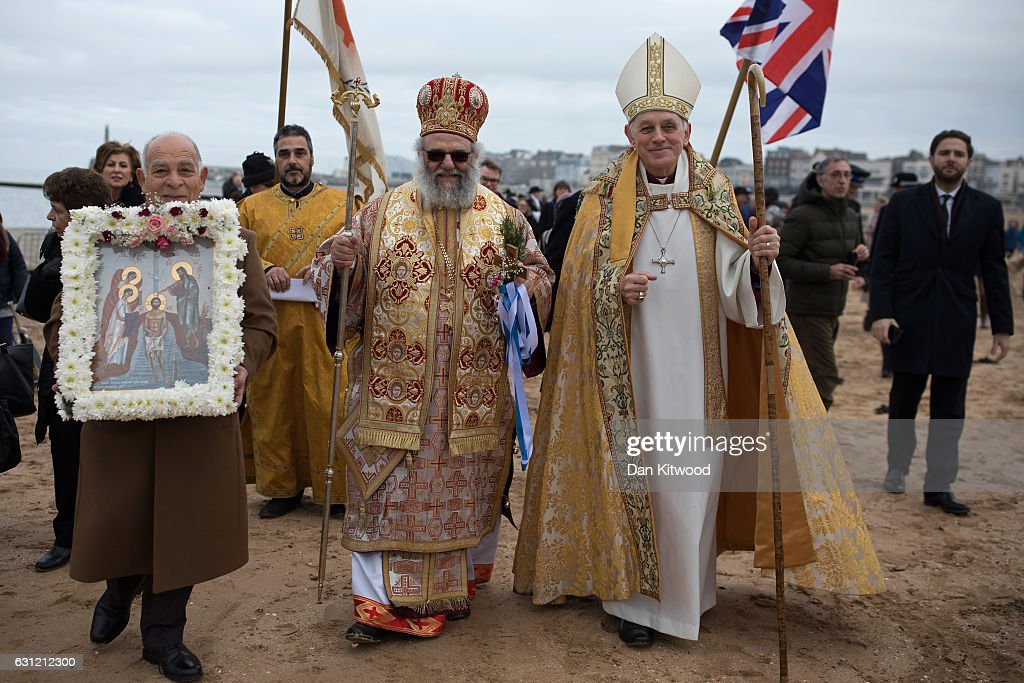 Trevor Willmot (R), Bishop of Dover, Bishop Athanasios (C) and parishioners and clergy of the Greek Orthodox Church of St Michael the Archangel process to Margate beach during traditional Greek Orthodox celebrations for the Feast of the Epiphany on January 08, 2017 in Margate, England. Greek Orthodox Epiphany celebrations have been taking place in Margate since the 1960s, a tradition commemorating the baptism of Jesus Christ in the Jordan River.