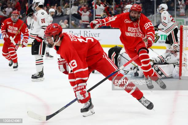 Trevor Zegras of the Boston University Terriers celebrates with Matthew Quercia after scoring a goal during the third period of the 2020 Beanpot...