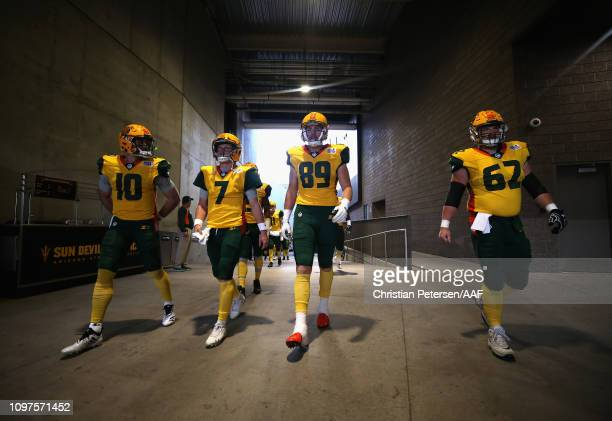 Trevor Knight John Wolford Connor Hamlett and Jacob Ohnesorge of the Arizona Hotshots walk down the tunnel for player introductions before the start...