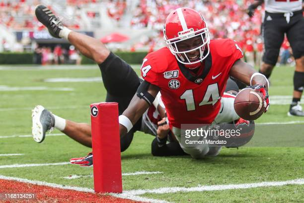 Trey Blount of the Georgia Bulldogs reaches for a touchdown in front of Jaden Harris of the Arkansas State Red Wolves during the second half of a...