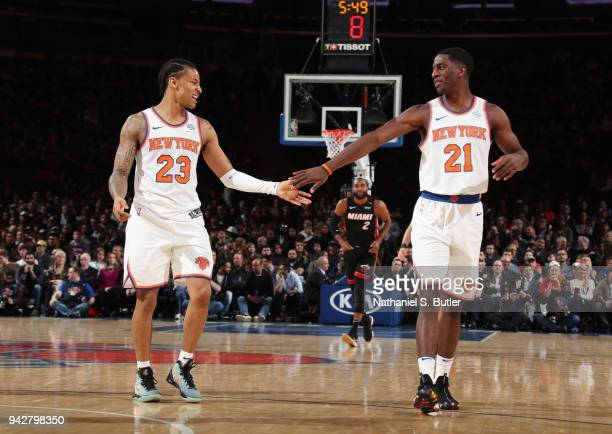 Trey Burke and Damyean Dotson of the New York Knicks high five during the game against the Miami Heat on April 6 2018 at Madison Square Garden in New...