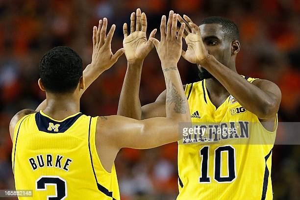 Trey Burke and Tim Hardaway Jr #10 of the Michigan Wolverines react to a play in the secon dhalf against the Syracuse Orange during the 2013 NCAA...